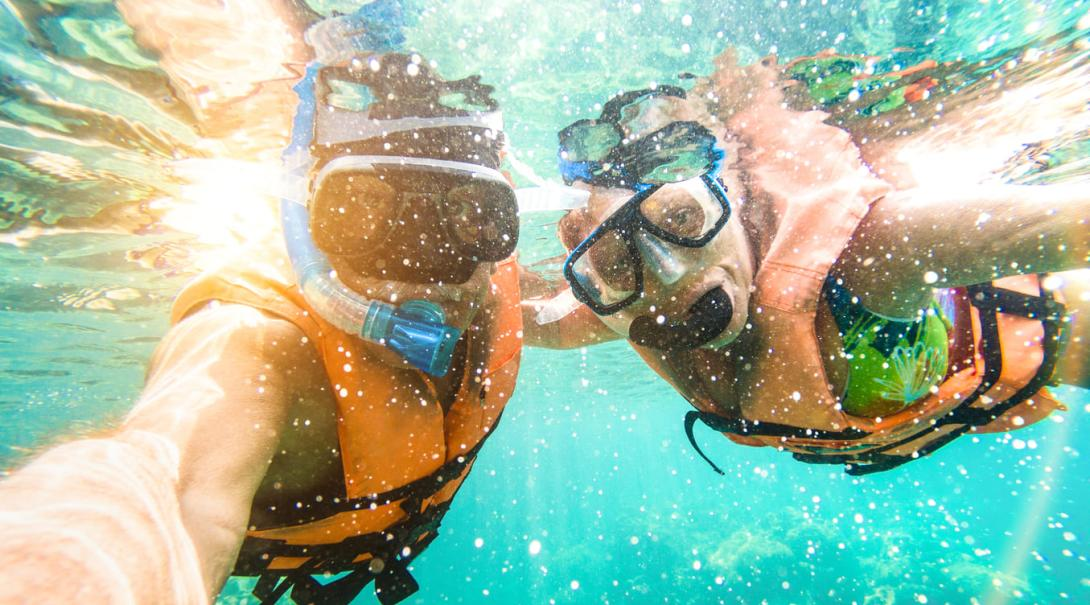 A couple go snorkelling during their Authentic Adventure in Fiji.